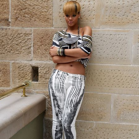 <p>Never one to do things by halves - Rihanna rocked tribal-esque printed jeans with a matching crop top for maximum impact</p>
