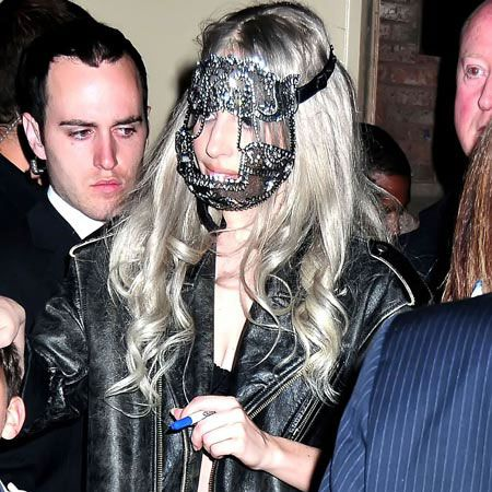 The anything-but-shy singer left a charity bash to celebrate the Rainforest Fund's 21st Birthday in New York with this latest diamante contraption across her face. That's certainly one way to protect a made-up face...  <br />