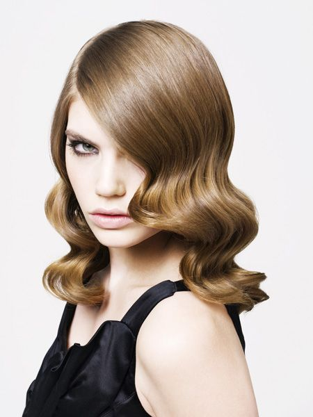 "<p>The epitome of modern glamour with a classic Hollywood vibe, achieve this look yourself with styling irons or via your stylist for a special occasion. The chestnut brown shade is gorgeous too.</p>  <p>Flatters face shapes: Oval, heart, square.</p>  <p>Neil Smith at Barrie Stephen Hair salons, Leicestershire. Tel: 0844 445 2888 <a target=""_blank"" href=""http://www.barriestephenhair.co.uk"">www.barriestephenhair.co.uk   </a></p>"