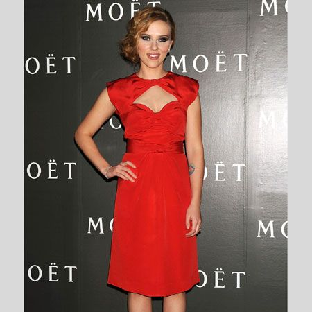 <p>The curvaceous Scarlett shows a sexy hint of cleavage with this cut out dress</p>