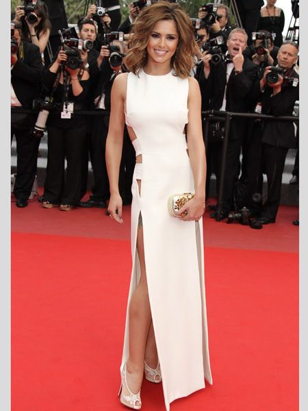 <p>Cheryl attended the 'Outside the Law' premiere looking super glam in a cut-out white dress with thigh high splits</p>