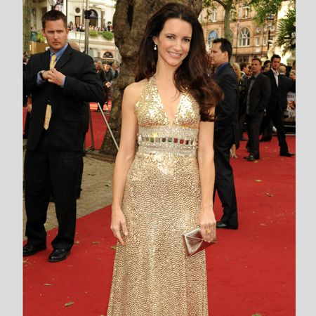 <p>Pretty Kristen wowed the crowd in a glitzy gold gown by Norman Norell </p>