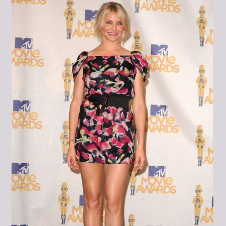 <p>Cam paraded those perfect pins in a printed mini dress with matching black accessories</p>