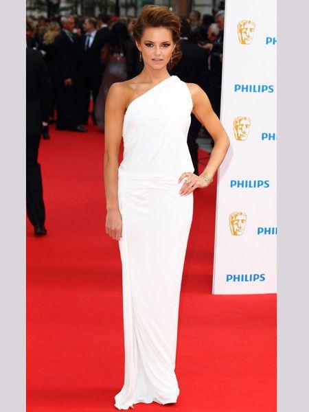 <p>Kara looked uber elegant in an asymmetric floor-length gown by Donna Karan </p>