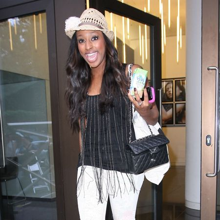 Woah, quite a lot going on here with Alexandra Burke: straw fedora hat, quilted Chanel purse <em>and</em> spangly vest. Luckily the X Factor winner's final accessory, a beaming smile, pulls it all together rather nicely