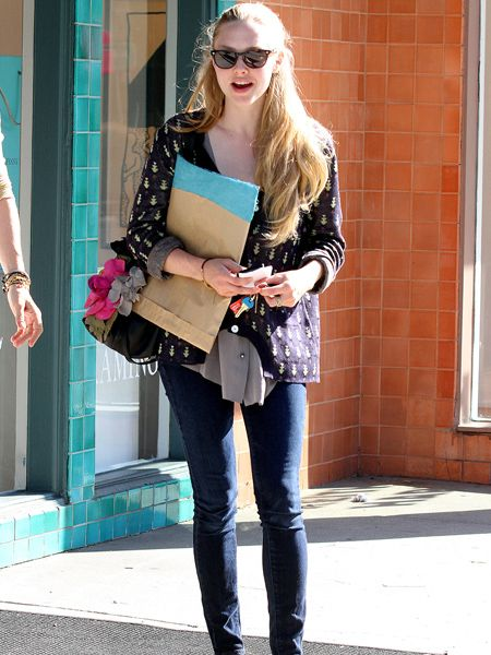 Amanda Seyfried must be the envy of Hollywood with those locks (all completely real!) - her tresses mean she looks glam even on a dress-down day. The Raybans, skinny jeans and cute Aztec-print jacket certainly don't hurt things either