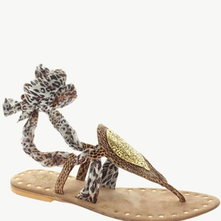 """<p>Walk tall in the safari trend with these hot animal print sandals with tie-up straps</p><p>£18, Park   Lane at <a target=""""_blank"""" href=""""http://www.asos.com/countryid/1/Park-Lane/Park-Lane-Tribal-Detail-Flat-Sandal/Prod/pgeproduct.aspx?iid=1167841&MID=35718&affid=2134&siteID=0RpXOIXA500-ghZozpBdb.J74uE0hqx4wg"""">www.asos.com</a></p>"""
