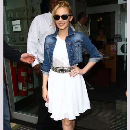 <p>Kylie Minogue's white chiffon dress is very summery.  On a mild summers day she added a Topshop cropped jacket to look cool, when the temperatures cool.  The Giuseppe Zanotti ankle boots are a tad OTT for my liking.</p>