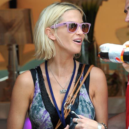 The singer Sarah Harding was spotted at Wireless festival in a pair of pink Wayfarers as she drank a Redbull and soaked up the sun in London's Hyde Park...  <br />
