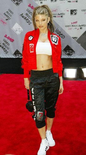 <p>Sportswear and ab-baring crops used to be the Fergie staple... with a rock-hard midriff like that, who could blame her?</p>