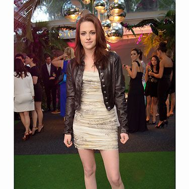We know that Kristen loves a bit of tough luxe when it comes to her fashion tastes, so it was no surprise when she managed to pull off this fab combo&#x3B; edgy biker jacket with a delicate mini dress and heels for an ultimate bad girl vibe!