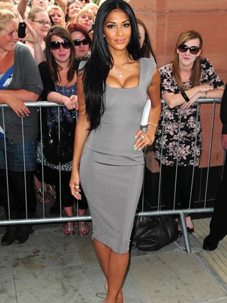 <pre /><p>Nicole Scherzinger showed off her enviable figure and ample bust in a flattering Victoria Beckham creation as she guest judged the 'X Factor' auditions in Manchester..  </p><pre><pre><br /></pre>  </pre>