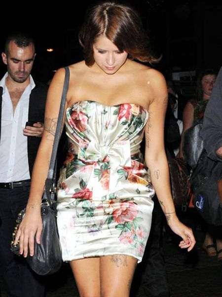 <p>Peaches Geldof smartened up in a floral frock as she flew back from LA for the UK premiere of 'Inception' in London's Leicester Square...</p>