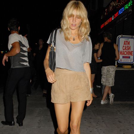 Clad in Topshop, Si shows how the high street can lend you an A-list look. Her high-waisted shorts, sheer top and fierce booties look perfect for balmy summer nights