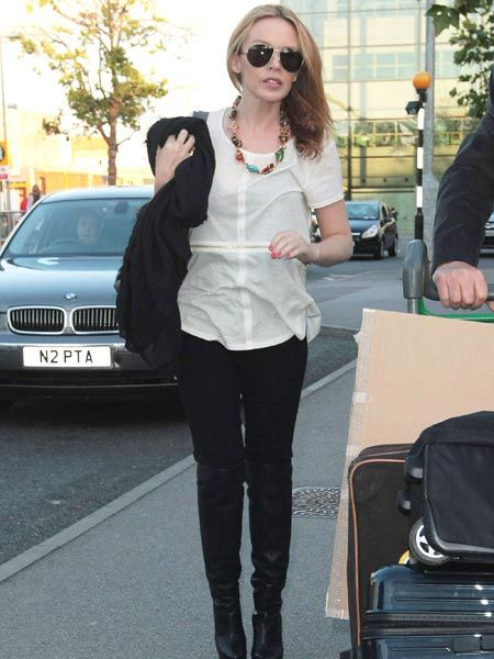 Kylie Minogue was spotted arriving at Heathrow airport to catch a flight to Melbourne to see meet her baby nephew Ethan for the very first time...  <br />