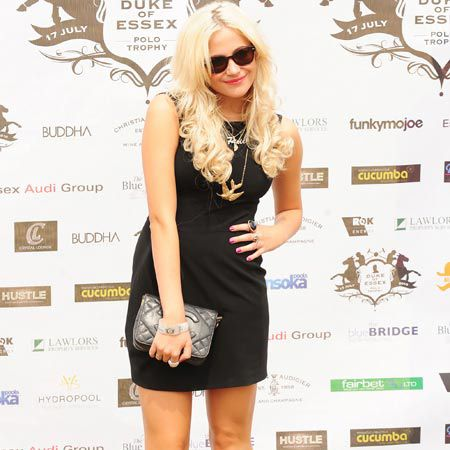 Pixie Lott added some style and glamour to the Duke of Essex Polo match in her LBD and matching Chanel clutch. Apparently the poor star was chatted up at the event by notorious ladies' man Jack Tweed, who she swiftly rebuffed. That's our girl!  <br />
