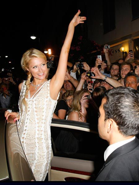 Paris Hilton just hates attention! The socialite waved and cheered at the crowd outside Papagayo nightclub in St Tropez for another night of free flowing cristal and table dancing...  <br />