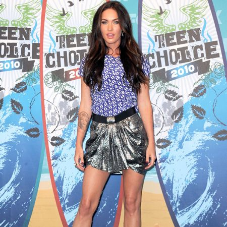 <p>Megan Fox combined a silver lamé skirt with a high neck printed tee. Do the separates look like they belong to the same outfit? </p>