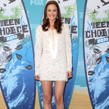 <p>Cosmo cover girl Leighton Meester rocked the romantic trend in a lace Emilio Pucci number with some girlie Louboutin heels with supersized corsages. Does she do girlie glamour to a T? </p>