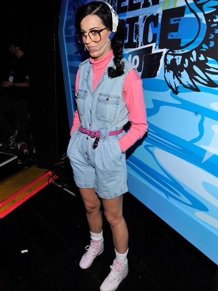 <p>The evening's host, Katy Perry dressed up in various ensembles. One being this geeky getup complete with specs and metal head gear. Does she make a hot nerd?</p>