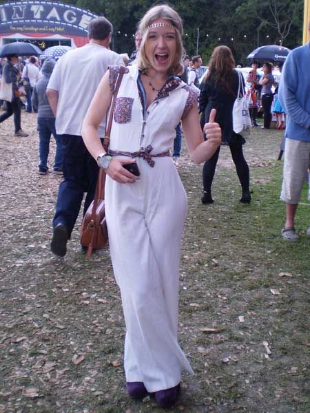 Lena goes all 70s rocking a Beyond Retro jumpsuit with purple Office wedge boots and a H&M headband at Vintage at Goodwood festival