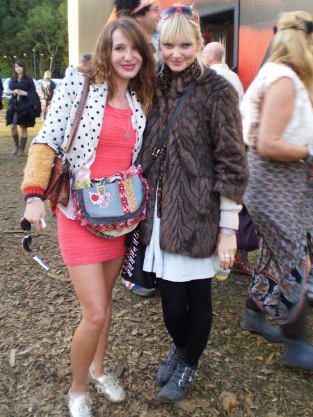 Mercedes, (right) wears Topshop dress, Miss Selfridge jacket and a cardie made by her nan. Estelle, (left) wears a French Connection dress under at River Island faux fur coat at Vintage at Goodwood