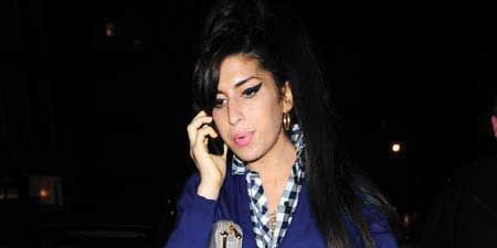 Click through to see the celebs posing for the paps<br /><br />Left: <strong>Amy Winehouse</strong> covered up her surgically enhanced assets (for a change!) as she went for a fish supper with friends in London...<br /><br />