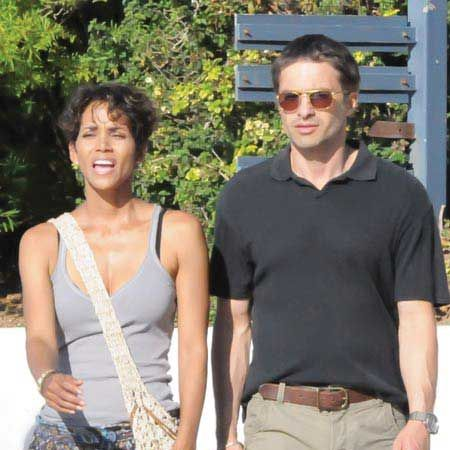 Halle Berry was seen looking cosy with dishy French actor Olivier Martinez - but the pair were only set for a new film, 'Dark Tide', in Cape Town...<br /><br />