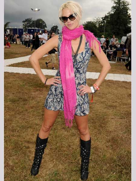 <p>The Girls Aloud singer added some serious glamour to the field-based frolics at V in her floating frock with a fuchsia scarf that added a bold punch to her look, then toughen it up with biker boots and added superstar status with winged shades </p>