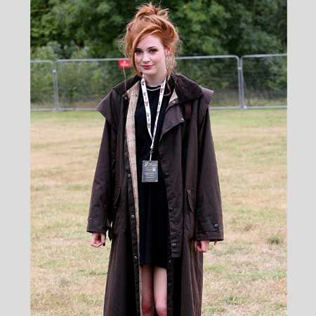 <p>Marking out her territory as a style icon the Dr Who actress kept both her beauty and fashion simple with a black dress, dramatic long coat complimented with relaxed hair in the form of a loose top knot. As the rain poured down, Karen didn't run for cover she danced all through the showers - we love her! </p>