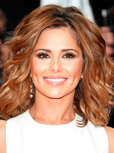 We love Cheryl's mid-length look. To achieve this look, set your hair in rollers diagonally so they're directed away from the face. Unravel when cool and blow-dry with a brush, going in different directions to get Cheryl's separated texture.