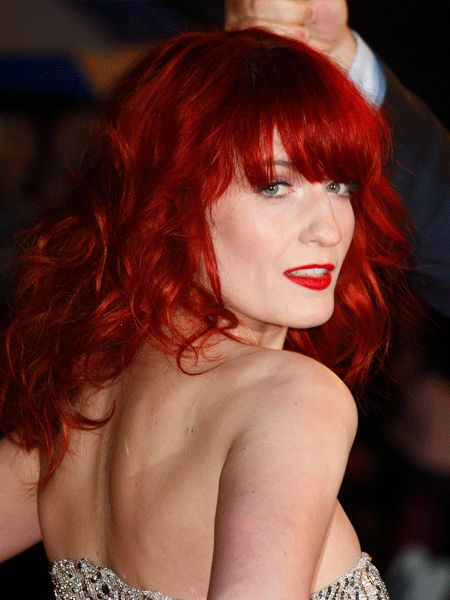 Florence's hair has serious wow-factor. To get her look, bag yourself an eye-skimming fringe and a texture spray through the rest of the hair to maintain a rock-chick look