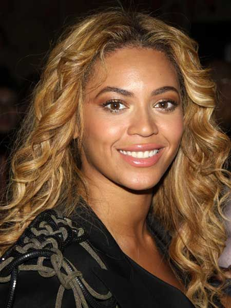 <p>Check out Cosmo's hair timeline of the beautiful, booty-shaking Beyonce Knowles!</p>  <p><strong>Left:</strong> Beyonce as we know her now, sporting a flattering golden hue and soft, tumbling curls. We have serious hair envy... </p>