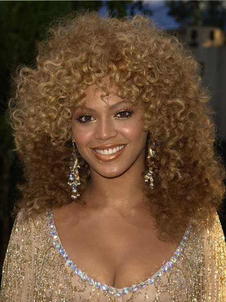 After her appearance in Austin Powers: Goldmember as Foxy Cleopatra, Beyonce embraced the seventies and opted for this gorgeous multi-tone afro for the premiere... we're loving the apt golden highlights!