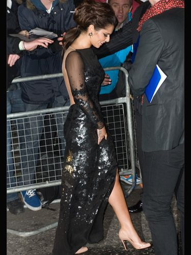 Cheryl wore a backless black sequinned gown to the Brit Awards, making her legs look longer by wearing perfect nude pumps. Evening glamour at its finest!