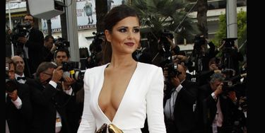 <h3>Cheryl Cole is officially the nation's style sweetheart; we love everything about her, from her flawless features right up to her ability to rock a frock  like no other. We can't get enough of her dolly gorgeousness. Here are some of her hottest high voltage glamour looks for you to drool over... </h3>  <p><strong>Left:</strong> Cheryl wowed at Cannes in a white Stephane Rolland gown with a plunging neckline.</p>