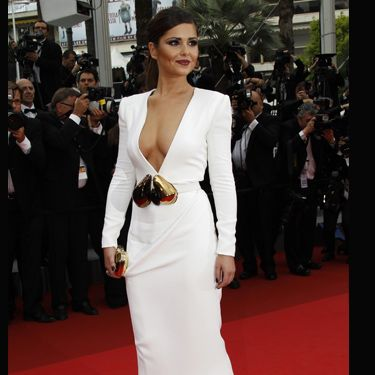 <h3>Cheryl Cole is officially the nation's style sweetheart&#x3B; we love everything about her, from her flawless features right up to her ability to rock a frock  like no other. We can't get enough of her dolly gorgeousness. Here are some of her hottest high voltage glamour looks for you to drool over... </h3><p><strong>Left:</strong> Cheryl wowed at Cannes in a white Stephane Rolland gown with a plunging neckline.</p>