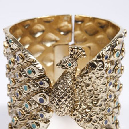 """<p>We heart House of Harlow jewellery and this peacock cuff designed by Nicole Richie is a perfect example why. It'll inject instant LA luxe into any look</p><p>£157, House of Harlow at <a target=""""_blank"""" href=""""http://www.urbanoutfitters.co.uk/House-Of-Harlow-Peacock-Cuff/invt/5764467290002&bklist?cm_mmc=AffWin-_-Winter09-_-ShopStyle+UK-_-null"""">urbanoutfitters.co.uk</a> </p><p>Psst - for luxe for less look to Miss Selfridge for glam wrist wear!</p>"""