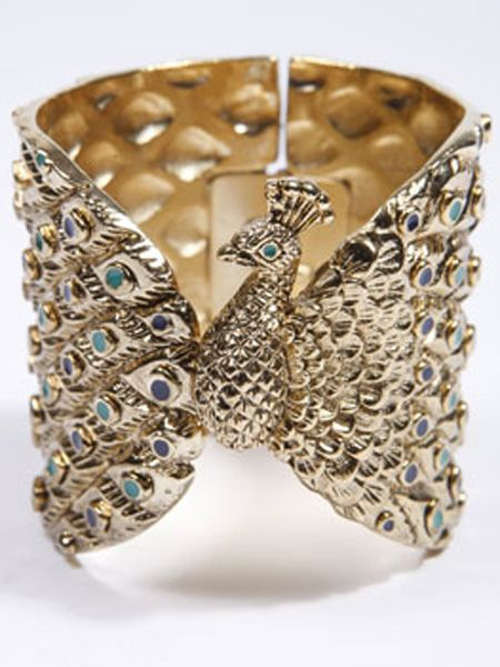 """<p>We heart House of Harlow jewellery and this peacock cuff designed by Nicole Richie is a perfect example why. It'll inject instant LA luxe into any look</p>  <p>£157, House of Harlow at <a target=""""_blank"""" href=""""http://www.urbanoutfitters.co.uk/House-Of-Harlow-Peacock-Cuff/invt/5764467290002&bklist?cm_mmc=AffWin-_-Winter09-_-ShopStyle+UK-_-null"""">urbanoutfitters.co.uk</a> </p>  <p>Psst - for luxe for less look to Miss Selfridge for glam wrist wear!</p>"""