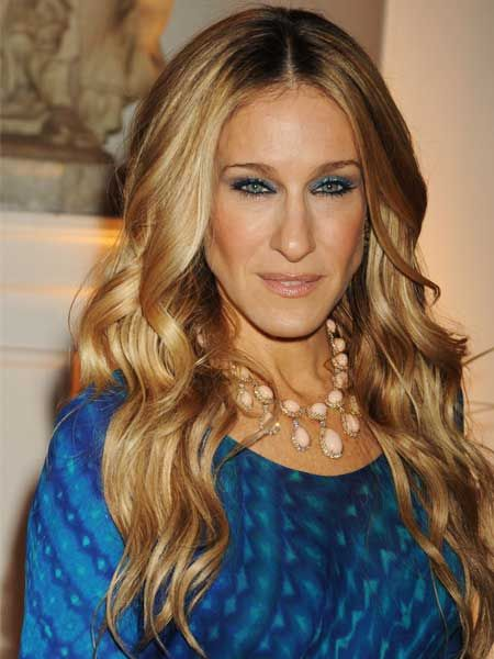 <p>Check out Cosmo's hair timeline of one of our biggest style icons, Sarah Jessica Parker!</p>  <p>Left: SJP as we know her now, with beautiful golden-blonde beachy waves</p>