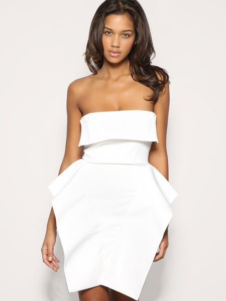 """<p>Little white dresses are still red hot. Team this super-cool structured number with tough ankle boots and attitude</p>  <p>£85, Aqua at <a href=""""http://www.asos.com/Aqua/Aqua-Structure-Hip-Dress/Prod/pgeproduct.aspx?iid=923594&SearchQuery=aqua&sh=0&pge=0&pgesize=20&sort=-1&clr=Ivory"""">asos.com </a></p>"""