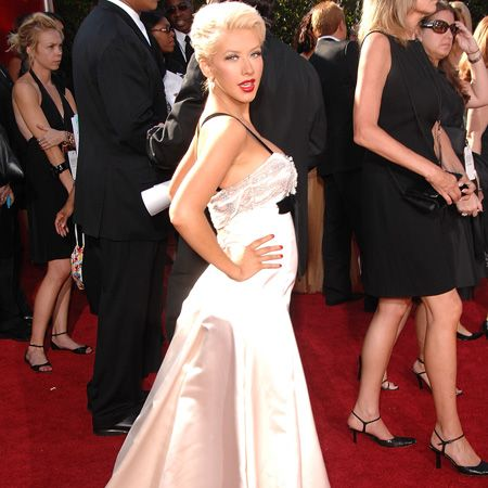 <p>Later that year at the Emmy Awards the star did a master class in pregnancy dressing in a floor length white silk number </p>