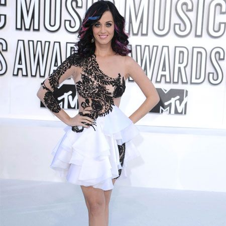 <p>Katy Perry made the most of her feminine wiles in this frilly asymmetric Marchesa dress with tattoo detail and layered tulle skirt. Black heels with star detail finished the outfit and stripes of blue and purple hair added that rebellious vibe we love from Ms Perry. What do you think to Katy's fashion choice?</p>