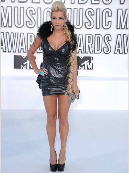 Ke$ha was all about the headline-grabbing outfit at the VMAs in a wet-look minidress with plunging neckline, outsized cocktail ring, platform heels, fur collar, topped with a blonde hairpiece and mismatching earrings. Whew! Too much or too hot?