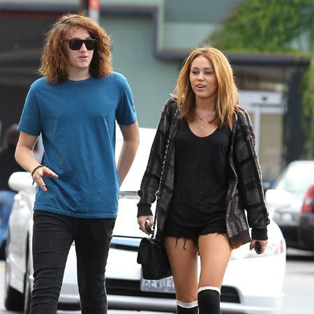 Miley Cyrus, who is apparently back with love Liam Hemsworth, was spotted out and about in LA and heading for brunch with brother Braison in LA...  <br />