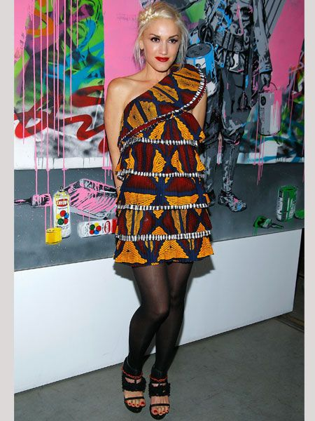<p>After her star-studded L.A.M.B. show, Gwen graced the after party wearing an amazing asymmetric tribal print frock with footless tights and statement sandals. Do you love these hot hues for autumn?</p>