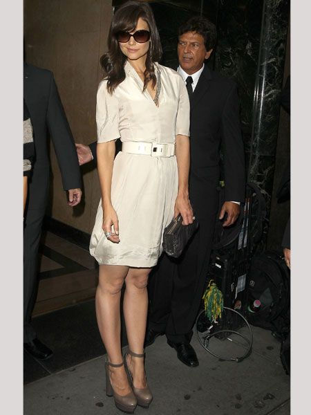 Katie was snapped outside the Calvin Klein show before taking her seat front row wearing a chic cream belted shirt dress teamed with sunnies and super-stacked greige Mary Janes. Think she relished in the opportunity to walk tall in her highest heels?<br /><br />