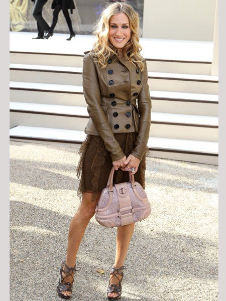 <p>Every girls's fave fashionista posed outside the Burberry Prorsum show before she took her front row seat next to Serena Williams and Alexa Chung. She wore a brown Burberry outfit with and Alexander McQueen handbag and strappy sandals by her current fave footwear designer, Nicholas Kirkwood</p>