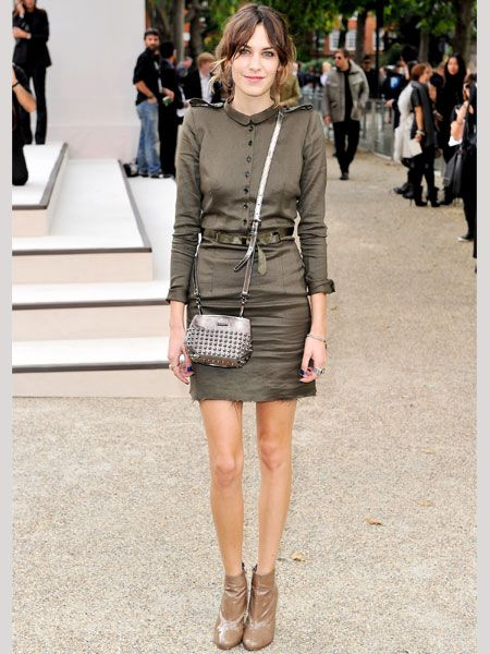 <p>Alexa too was clad in a khaki Burberry ensemble with gorgeous patent mocha ankle boots and a studded over-the-shoulder bag</p>