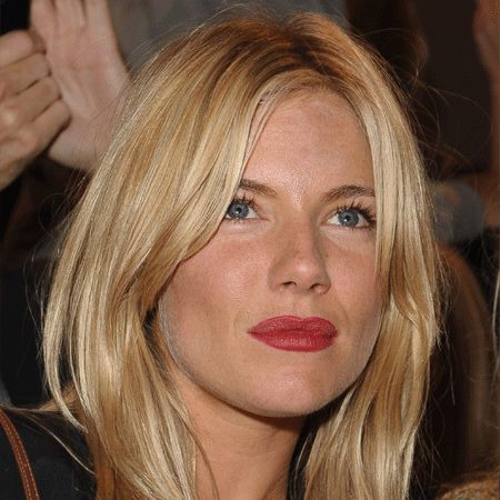 Sienna Miller's soft buttery-blonde locks have been allowed to fall loose around her face, giving her that effortless 'oh so sexy' vibe we all crave! A definite head-turner at the Matthew Williamson Collection